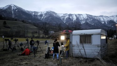 Video reporters work in Seyne les Alpes on Tuesday.