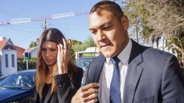 Remorseful and humiliated: Sara Hills and Geoff Huegill outside Waverley Local Court.
