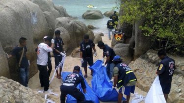 Thai police work near the bodies of two British tourists murdered on Koh Tao.