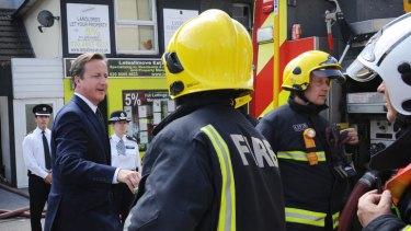 British Prime Minister David Cameron visits Croydon to view the destruction.