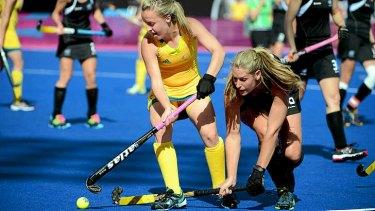 Australia's Emily Smith battles New Zealand's Clarissa Eshuis in their Olympic hockey pool match. The Kiwis won the match 1-0.
