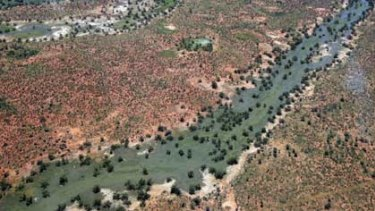 Hope returns ... the rivers are full but residents near Wanaaring, north-west of Bourke, need supplies from the SES.
