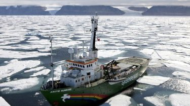Greenpeace ship Arctic Sunrise pictured in cracked and drifting ice in front of the Petermann Glacier (out of view) on Greenland's north-west coast.