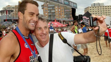 "Ironman Matt Poole with  Eddie 'Groover"" Cross who crashed a TV interview so he could get a 'selfie'."