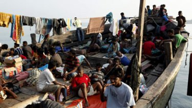 Hung out to dry ... Sri Lankan asylum seekers in the port of Merak, on the north-western tip of Java, yesterday.