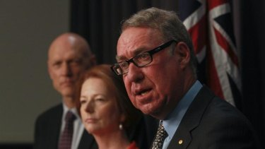 David Gonski, right, answers questions at the release of his schools report while Peter Garrett and Julia Gillard look on.