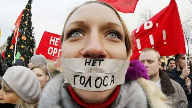 """""""No vote"""" ... a protester in St. Petersburg sends a message to Russia Prime Minister Vladimir Putin."""
