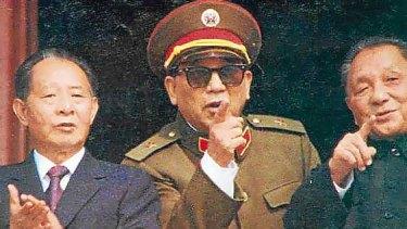 General Qin Jiwei (centre)  with Deng Xiaoping (right), in 1984.