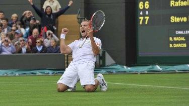 """Very happy"": Steve Darcis celebrates his win."
