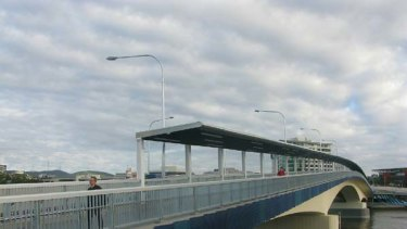 Pedestrians make use of Brisbane's latest river crossing.