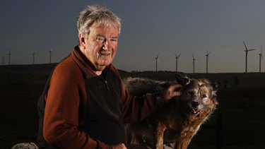 Blown away... George McLaughlin and his dog, Scooter, on the Tarago property he has left because of the noise from the nearby wind farm.
