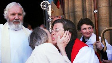 Hallelujah: The new Bishop Darling is congratulated outside St Paul's Cathedral after her consecration yesterday.