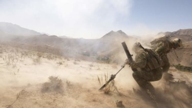 High pressure: Soldiers from the Special Operations Task Group on an operation in Oruzgan province.