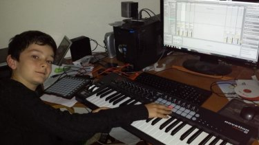 """Canberra boy Rhys Toms producing music in his """"studio"""", aka his dad's home office."""