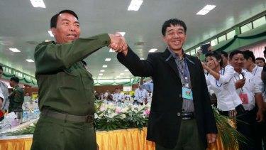 Sealing the deal: Myanmar Lieutenant General Myint Soe, left, and Deputy Chief of Staff Guam Maw.