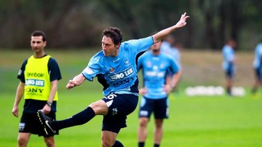 Back in the fold . . . former Sky Blue Mark Milligan works out with Sydney FC yesterday.