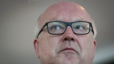 Canberra's legal fraternity has urged federal Attorney-General George Brandis to reverse savage cuts to the legal aid sector.