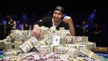 Smiling poker face ... Jonathan Duhamel poses after winning the World Series of Poker.