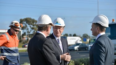 Victorian Premier Denis Napthine speaking with state Minister for Transport Terry Mulder and federal assistant minister for Infrastructure and Regional Development Jamie Briggs.