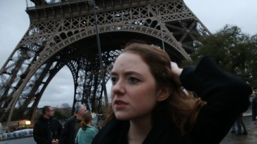 Tourists flee as Police clear the Eiffel Tower.