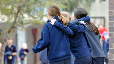 Once more with feeling ... Students at Mount Martha Primary School flout the hugging ban today.