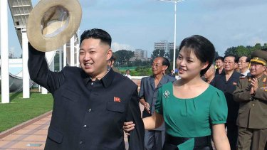 A picture released by North Korea's official Korean Central News Agency (KCNA) via the Korea News Service (KNS) on July 26, 2012  shows North Korean leader Kim Jong-Un (L), accompanied by his wife Ri Sol-Ju (R), visiting a wading pool at the Rungna People's Pleasure Ground in Pyongyang.