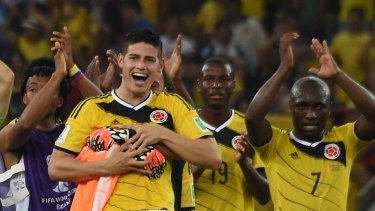 Good news for a nation ... Colombia's outstanding midfielder James Rodriguez and his teammates celebrate after defeating Uruguay 2-0 at the Maracana Stadium in Rio de Janeiro