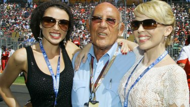 Fell down a lift shaft ... formula one legend Stirling Moss, pictured here with Dannii, left, and Kylie Minogue in Melbourne in 2007, has been seriously injured.