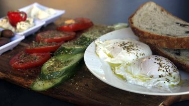 Mediterranean breakfast ... two poached free range eggs, natural yoghurt, fresh tomatoes, Persian fetta, kalamata olives and cucumbers served with organic olive bread.