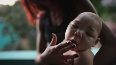 Estafany Perreira holds her five-month-old nephew David Henrique Ferreira, who has microcephaly.