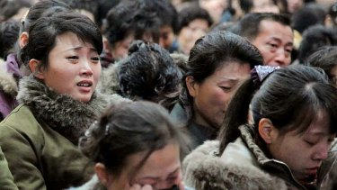 Tears for the 'Dear Leader' ... North Korean women cry after learning of death of Kim Jong-il.