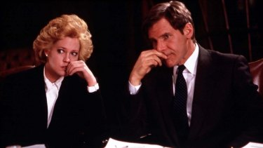 Melanie Griffith and Harrison Ford in the 1988 ode to the power suit,