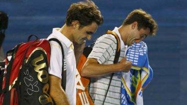 Clash of styles ... Roger Federer, left, and Gilles Simon.