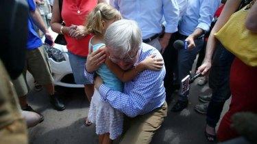 Prime Minister Kevin Rudd hugs Virginia Rudd at Parap markets in Darwin.