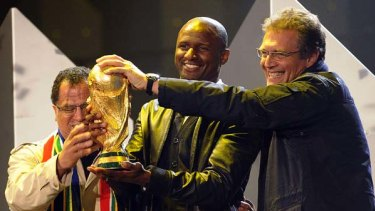 Controversial ... Patrick Vieira, centre, hands over the World Cup to Local Organizing Comitee Chief excutive officer Danny Jordaan, left, and FIFA Secretary General Jerome Valcke.