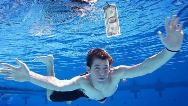 Now an adult, Spencer Eldon strikes a familiar pose recreating the album cover for Nirvana's Nevermind album. For much of America's grunge generation, a comfortable retirement now looks out of reach.