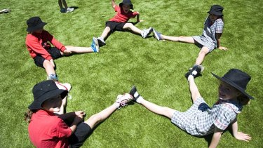 Points for PE: Torrens Primary School students in their playground. A study shows physical activity affects literacy and numeracy.