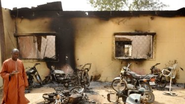 A man walks through the ruins of a zonal police headquarters after a bomb attack by Boko Haram in Nigeria's northern city of Kano in January, 2012.