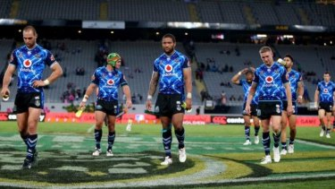 Disconsolate: The Warriors leave the pitch after their painful loss.