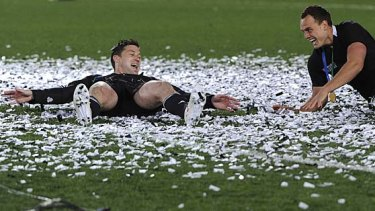 Party time ... Cory Jane and  Israel Dagg make snow angels in confetti.