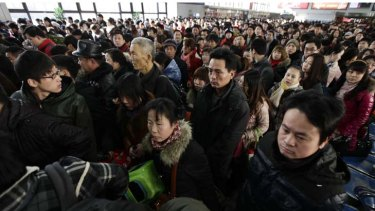 Homecoming ... passengers at Beijing's west railway station make the journey home for Chinese New Year.