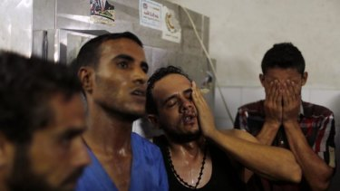Relatives of Palestinian children react following their death at a hospital in Gaza.