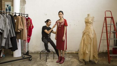 Designer Akira Isogawa with model Woan Ni Wooi.