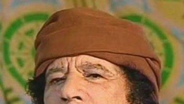 Muammar Gaddafi ... did not attend son's funeral.