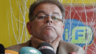 'We may sack him' ... Cofidis manager Yvon Sanquer speaks to the media.