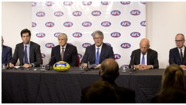 AFL chief executive Gillon McLachlan with (left to right) Kerry Stokes, AFL chairman Mike Fitzpatrick, and Rupert Murdoch as they announce the record-breaking deal.