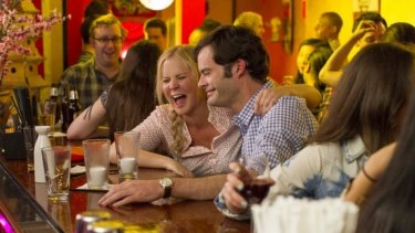 Amy Schumer and Bill Hader in <i>Trainwreck</i>.