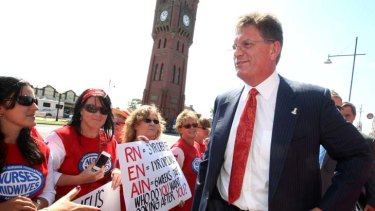 More than 2000 Victorian nurses walked off the job yesterday. Nurses, seen here confronting Premier Ted Baillieu in December, are involved in a long-running industrial feud with the government.