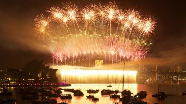 Lighting up the sky ... midnight fireworks seen from Mrs Macquarie Point.