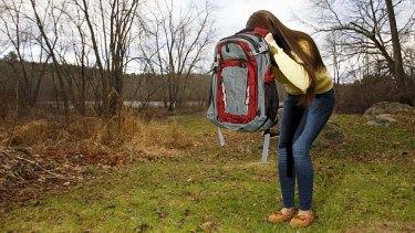 Amanda Curran, 18, daughter of Bullet Blocker inventor Joe Curran, demonstrates how to use a child's bulletproof backpack.